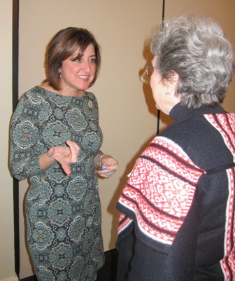 Susan Tillis speaking with an attendee