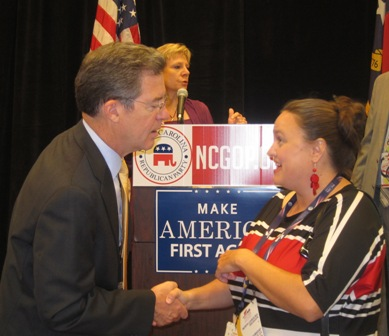 Emily Walker of Durham, North Carolina speaking with  Governor  Sam Brownback of  Kansas