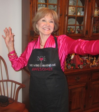 "Nancy with her ""This wine is making me awesome"" apron !!!   MERRY CHRISTMAS EVERYONE  !"
