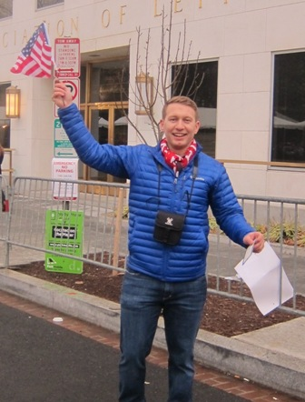 Trump supporter proudly holding up his admission card to the inauguration